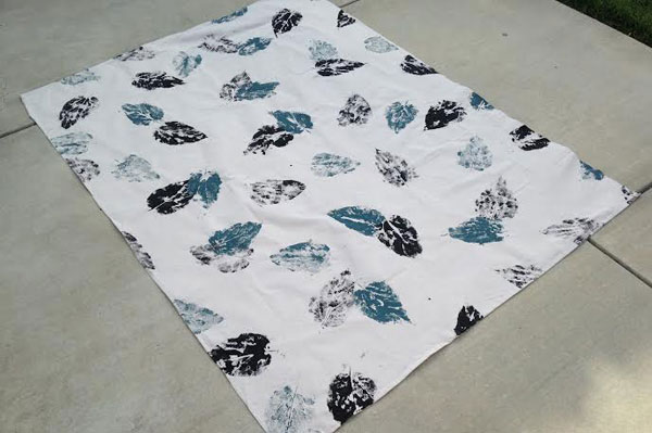 DIY Canvas Rug designed with leaves on painters drop cloth