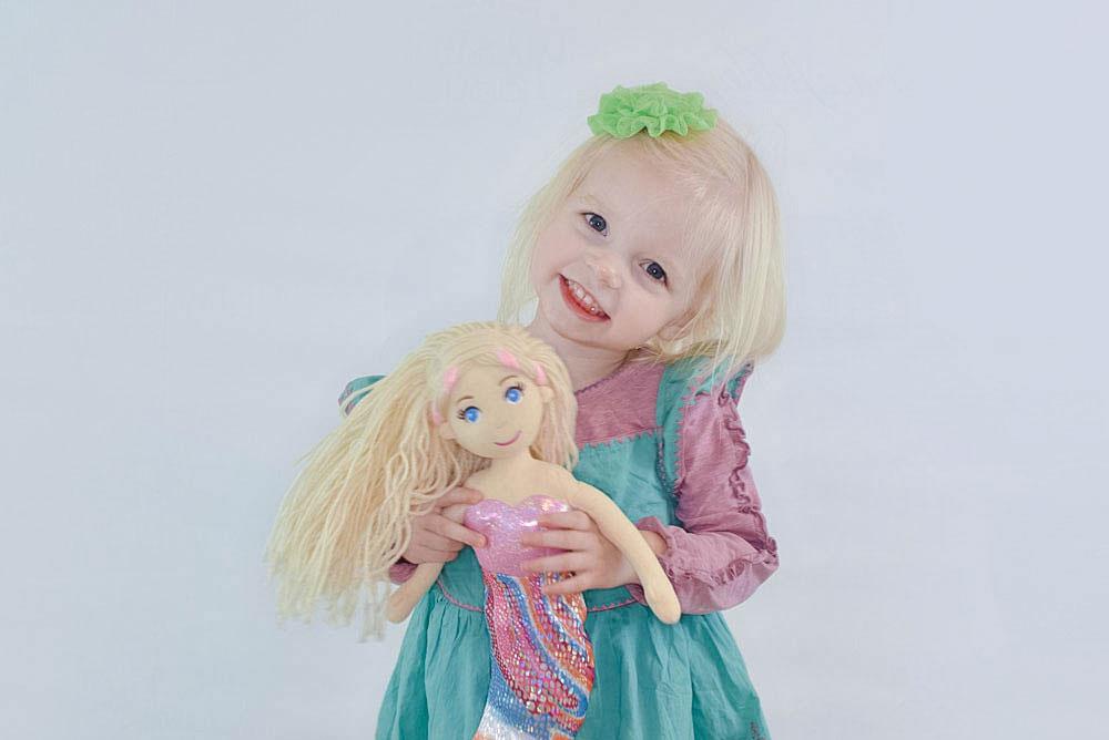 Little girl with mermaid doll and Matilda Jane dress - Mommy Scene