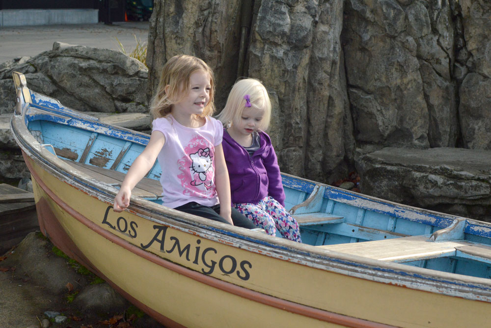 Family Day at the Seattle Woodland Park Zoo two girls in a boat - Mommy Scene