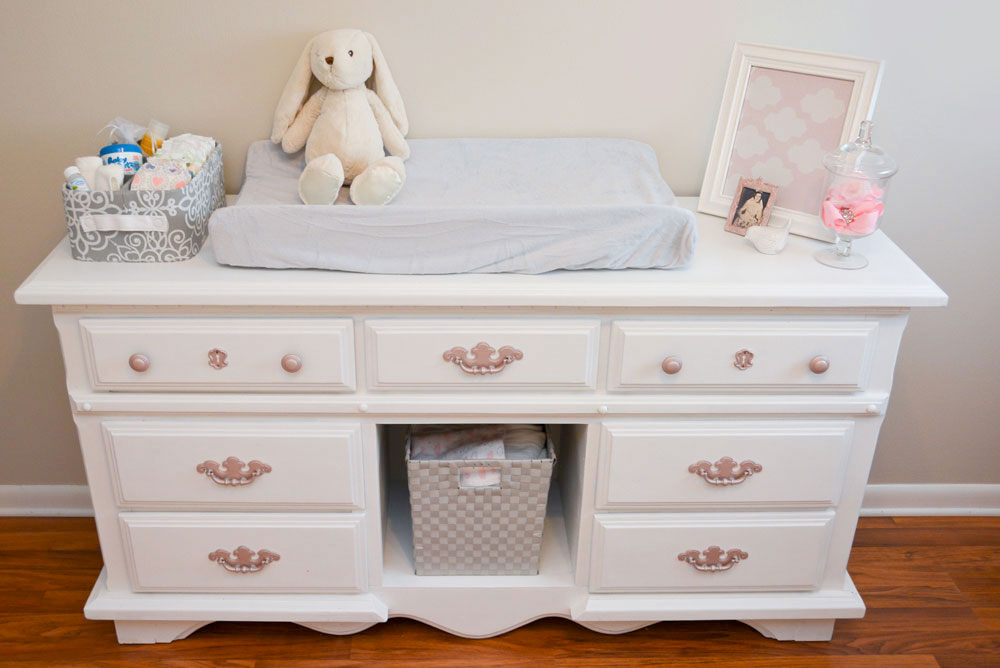 Baby Girl Nursery Tour - Mommy Scene - White crib with pink sheets and refurbished bookshelf with pink fabric in pink and gray baby room