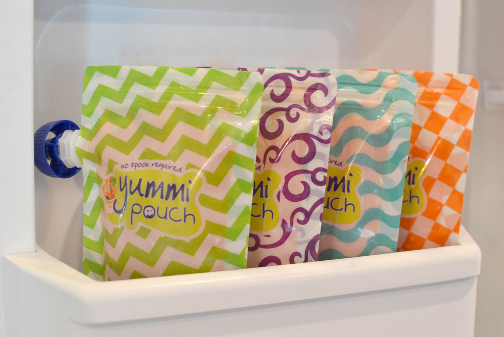 Easily store homemade baby food in Yummi Pouch reusable food pouches - Mommy Scene