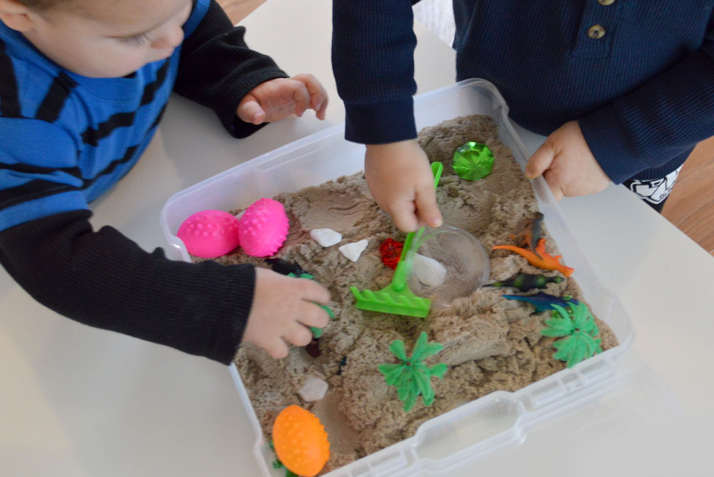 Dinosaur themed sensory bin for kids