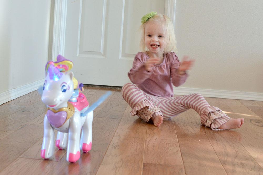 Little girl wearing Matilda Jane and Vtech Twinkle the Magical Unicorn - Mommy Scene