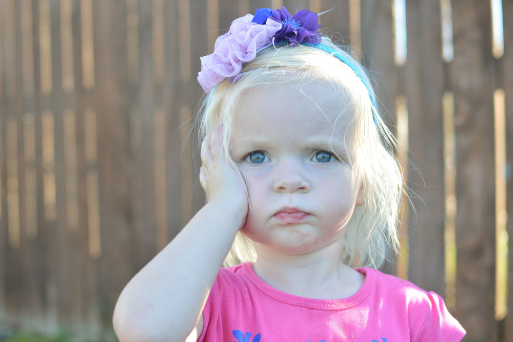 Toddler girl wearing a flower headband - Mommy Scene