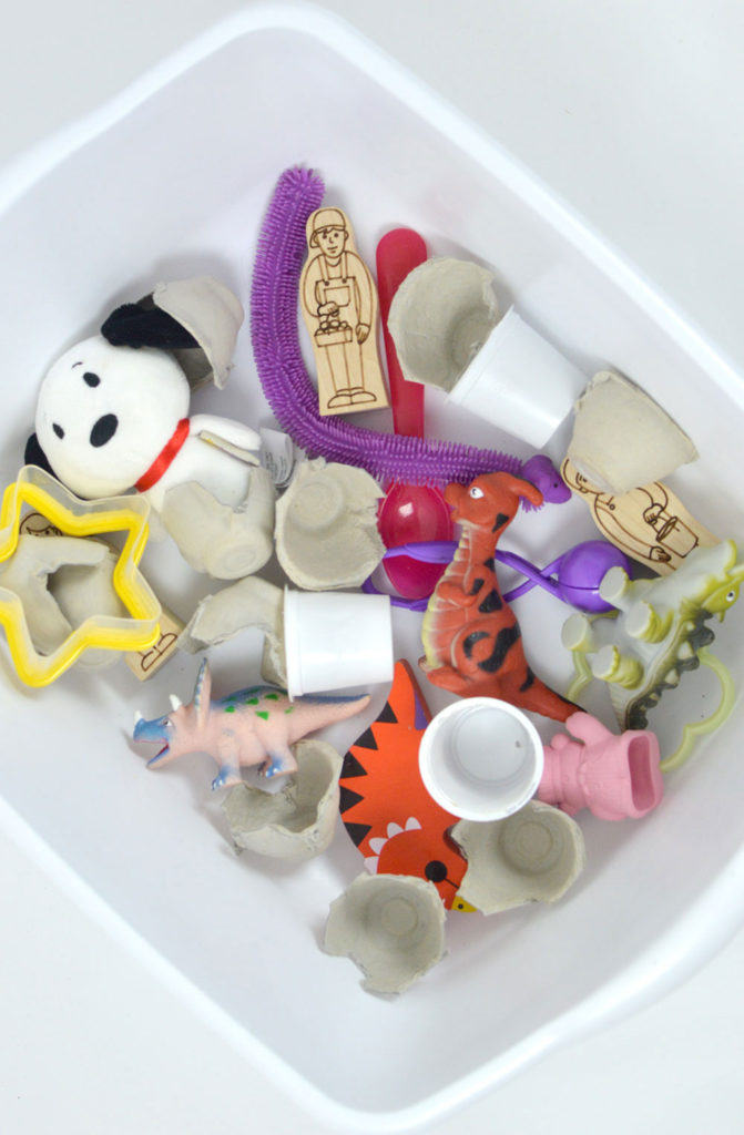 Fun baby and toddler sensory box with small baby safe items and toys - Mommy Scene