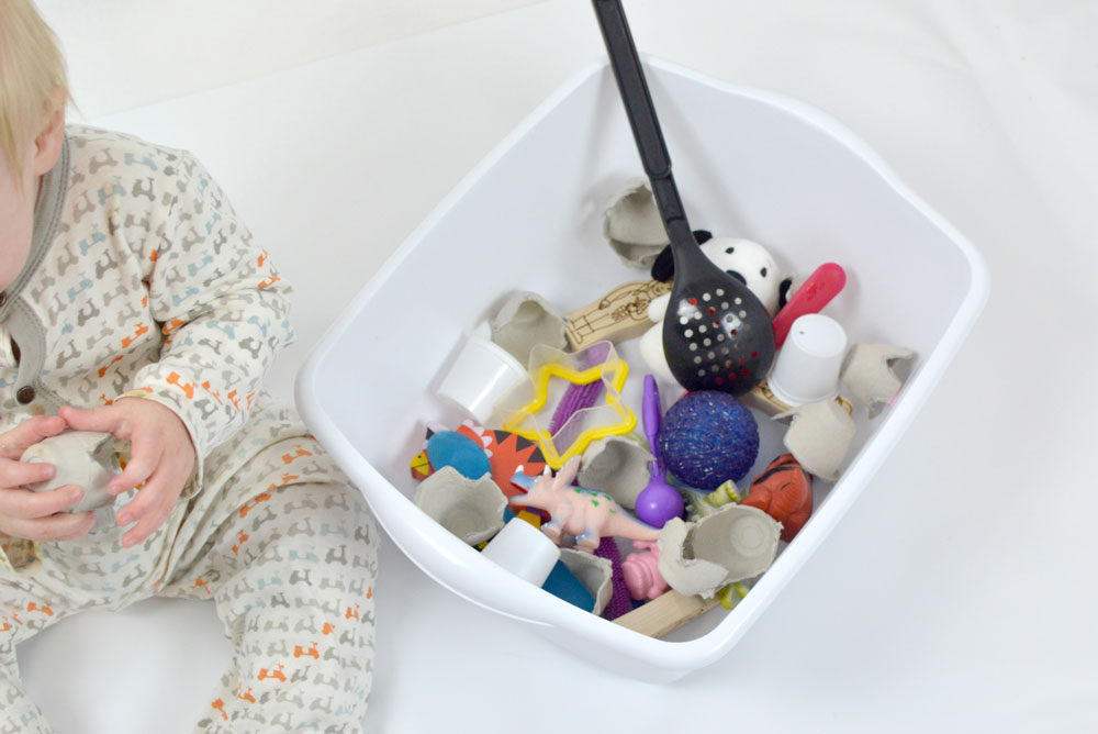 Create a sensory baby box with small baby safe items and toys - Mommy Scene