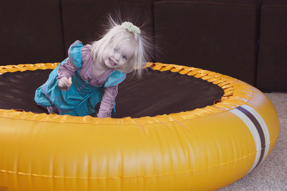 Toddler playing on The Shrunks trampoline pool - Mommy Scene review