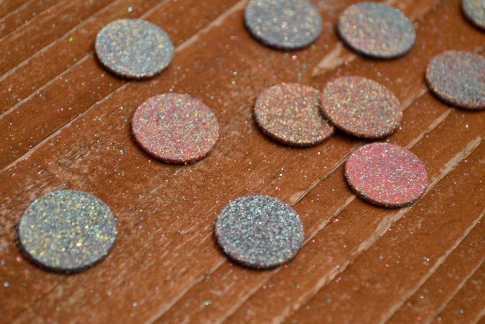 Glittery DIY tooth fairy coins make losing a tooth fun!
