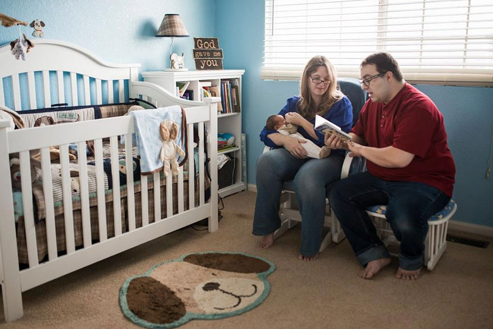 Parents and baby reading in the nursery - Mommy Scene