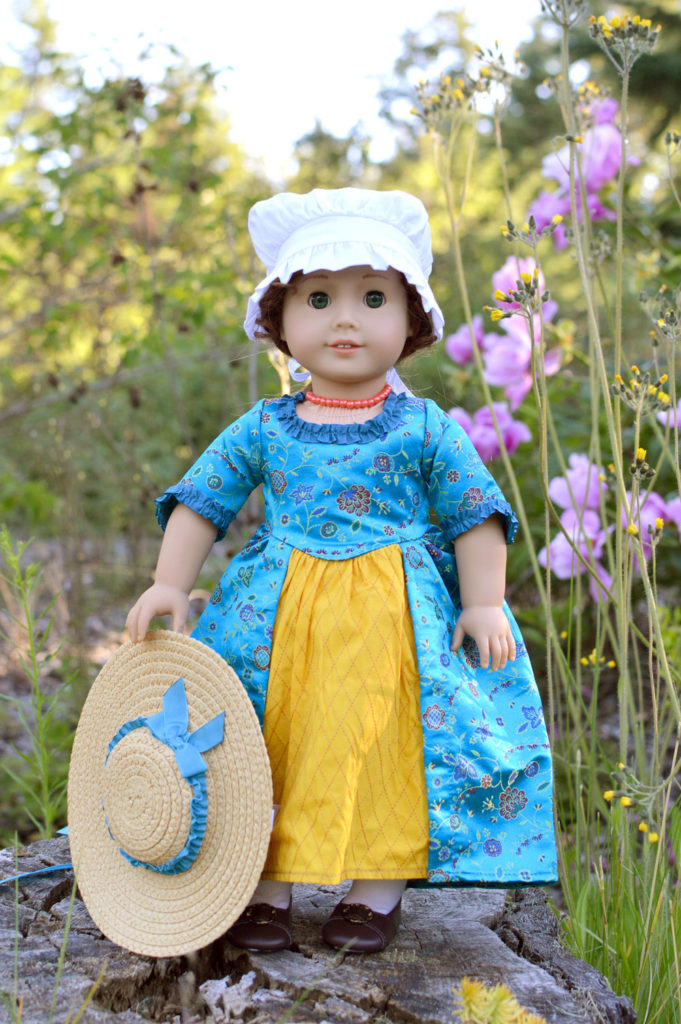 The Felicity American Girl doll comes with a darling blue dress that is gathered in the back and accented on the front with a contrasting yellow panel