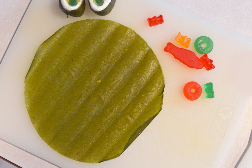 DIY Candy Sushi with fruit roll-ups, gummy candy, and marshmallows - Creative party idea