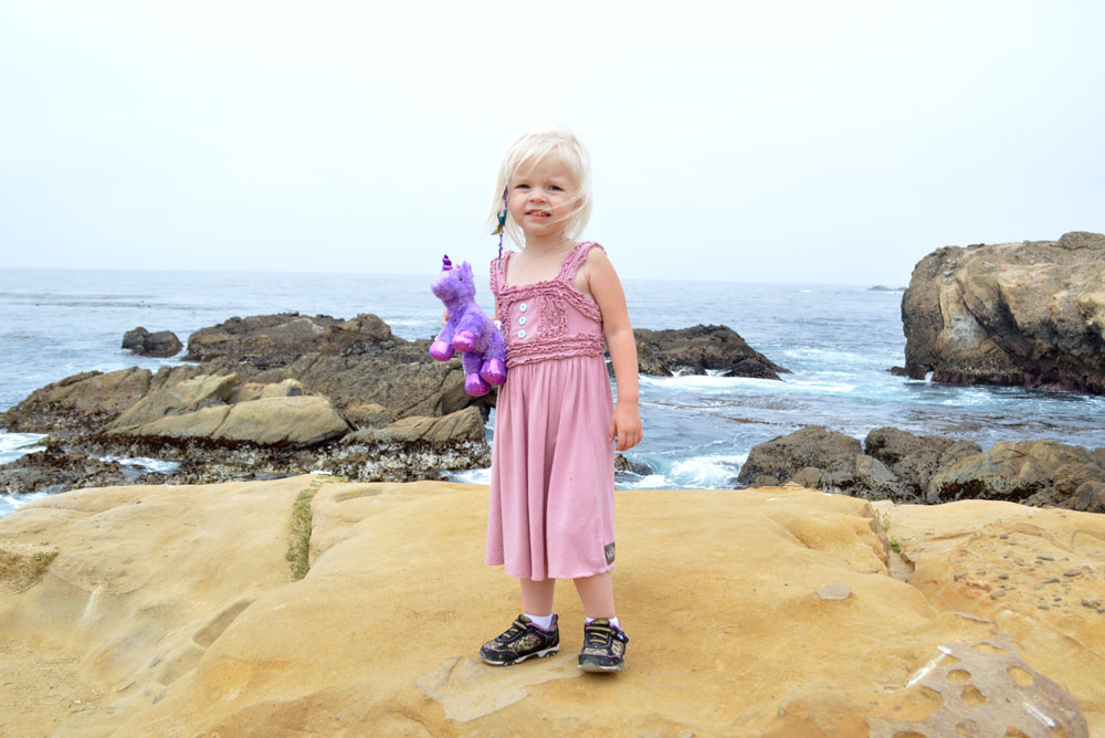 Easy way to tie back dress straps little girl at the beach - Mommy Scene