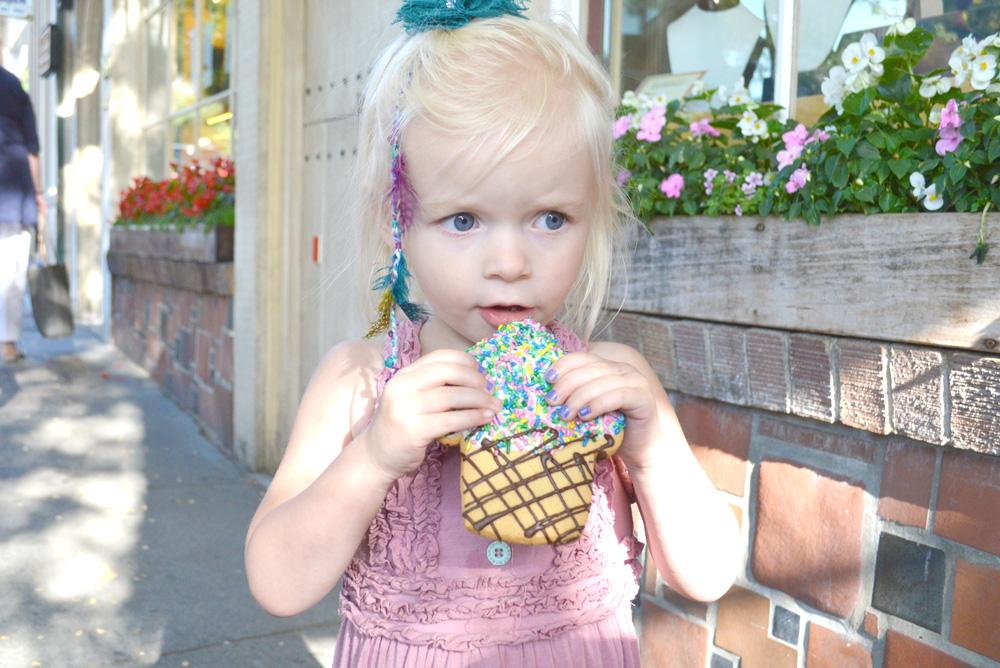 Enjoying cookies from the Carmel Bakery - Mommy Scene
