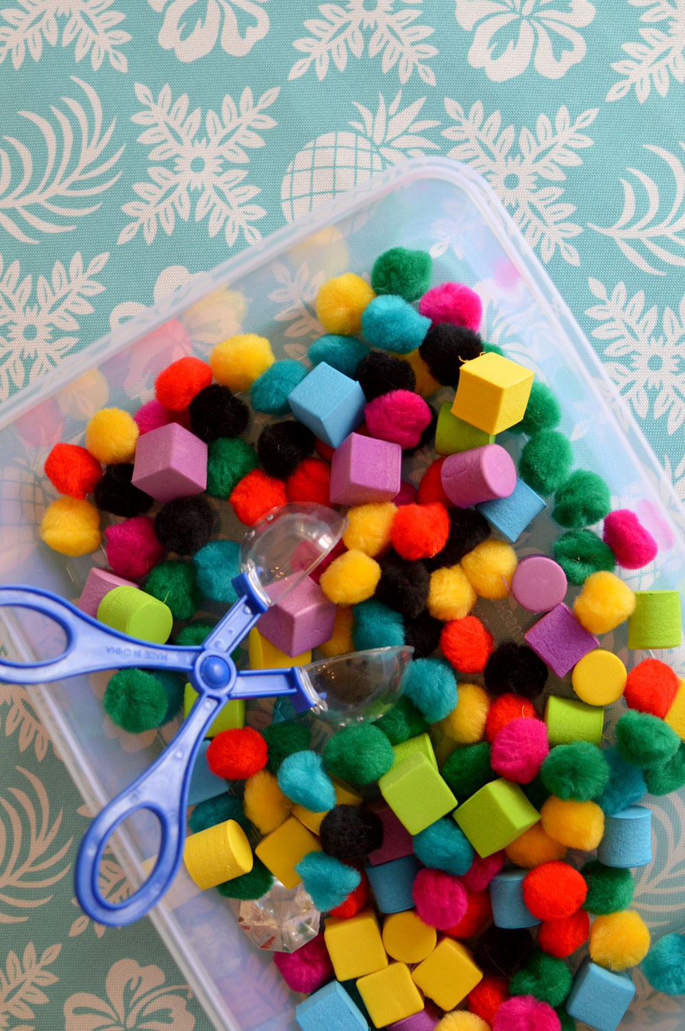 Playing with Pom Poms sensory toddler activity - Mommy Scene