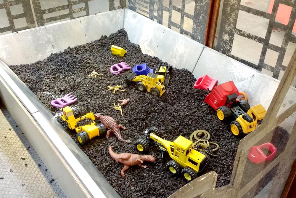 Mobius Spokane Children's Museum dinosaur and truck sensory box - Mommy Scene