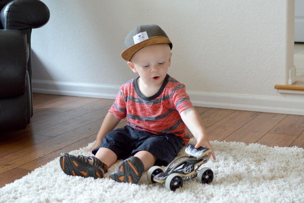 Baby boy with Hape toys e-Drifter - Mommy SCene