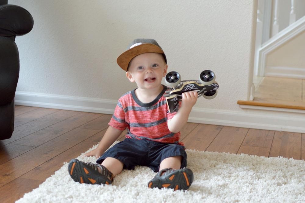Baby Cubby hape toys bamboo race car and Jack & Winn baby boy hat - Mommy Scene