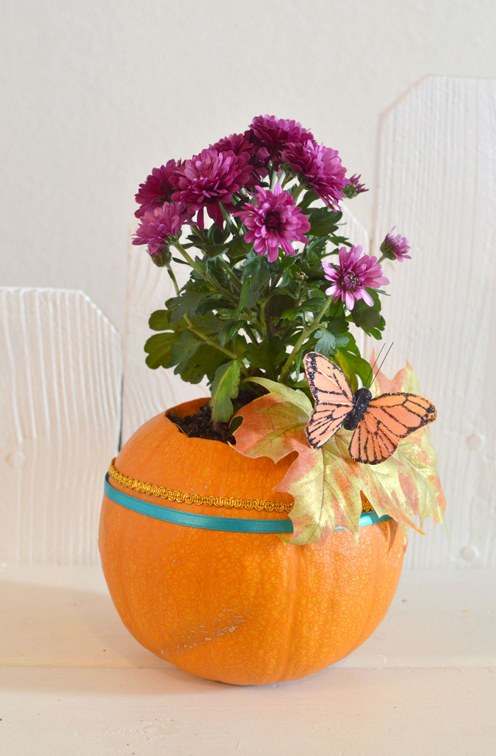 Stunningly Simple DIY Pumpkin Planter - Mommy Scene