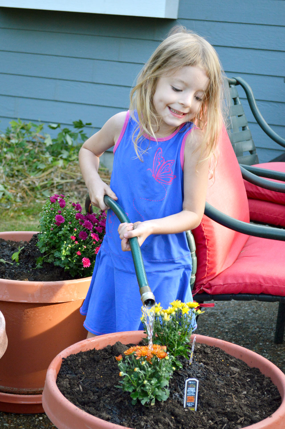Planting for fall and watering kids activity - Mommy Scene