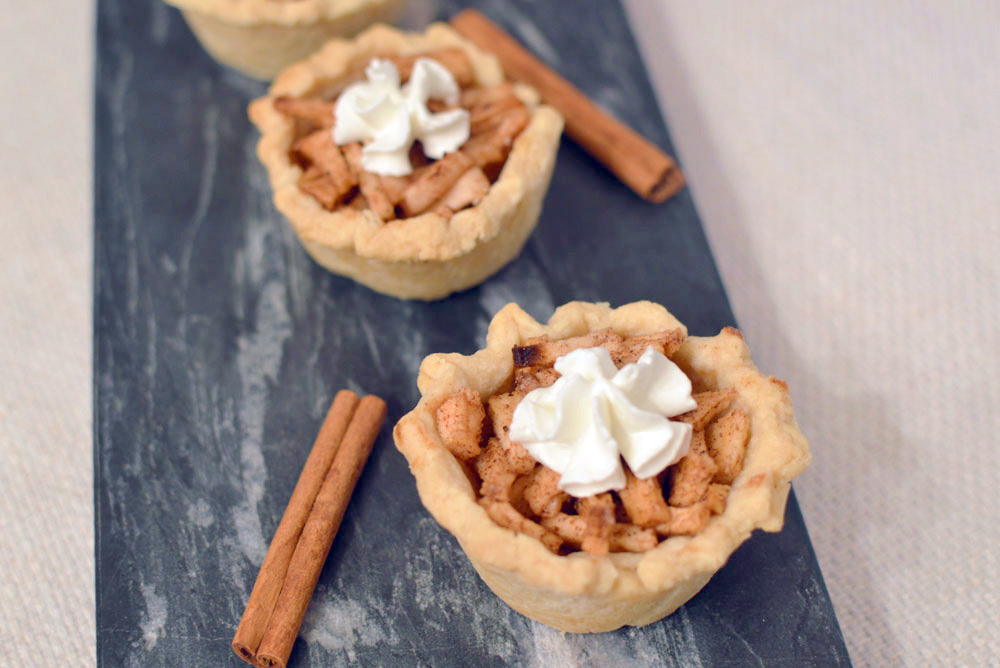 Bite-Sized Mini Apple Pies baked in a muffin tin - Mommy Scene