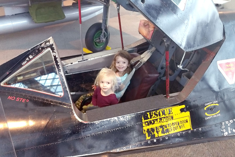 Seattle Museum of Flight sitting in a fighter jet - Pacific Northwest family trip