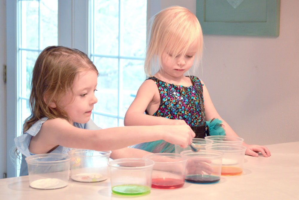 Baking soda and vinegar color science activity for kids