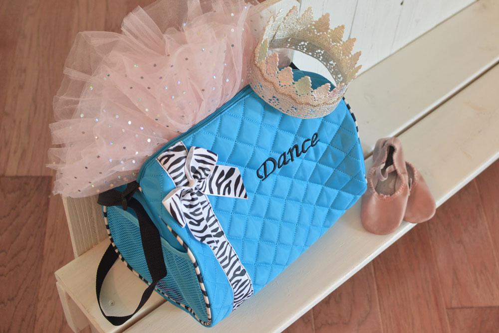 Just Unique Boutique aqua dance bag - Mommy Scene