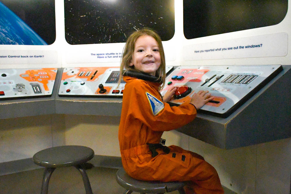 Denver Museum of Nature and Science family visit spaceship exhibit kids activity