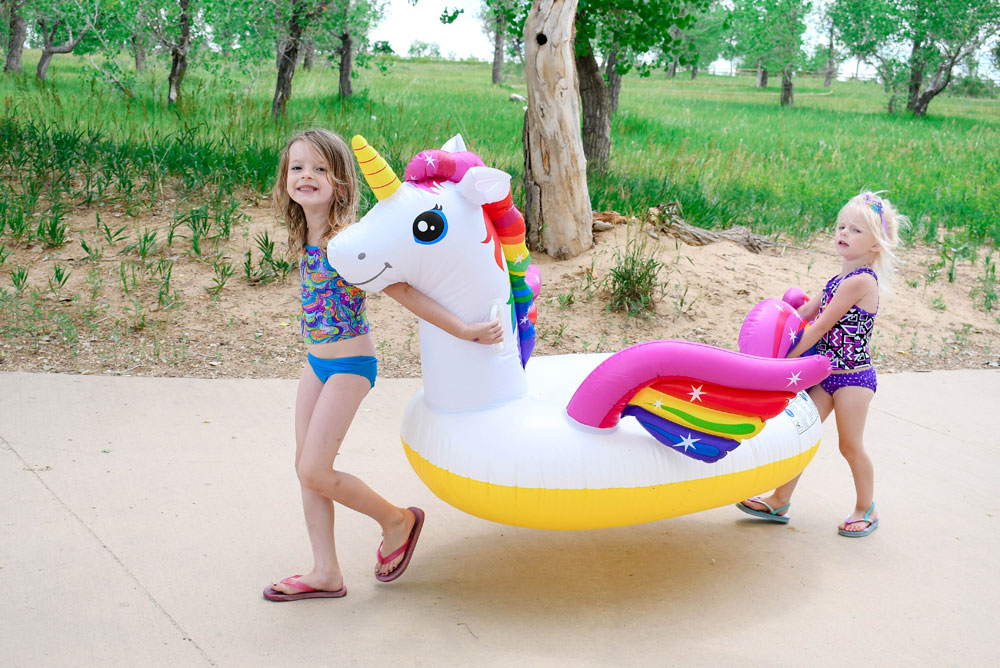 Taking a inflatable unicorn water toy to the lake