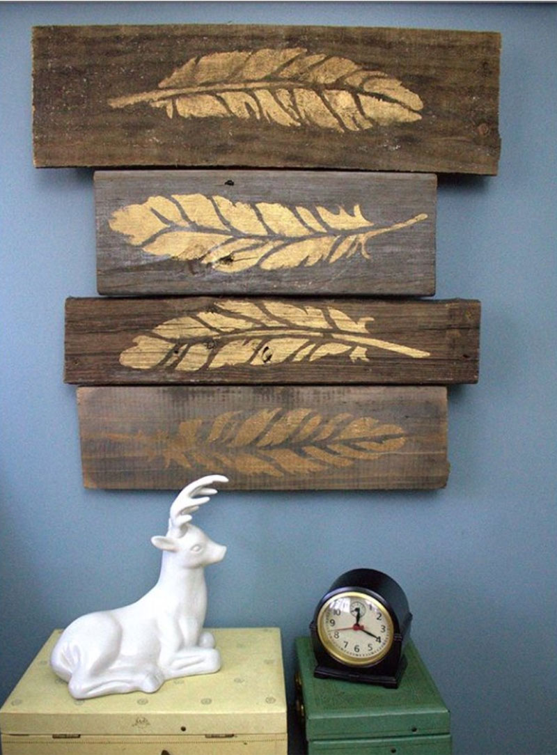 Wood wall art with painted feathers
