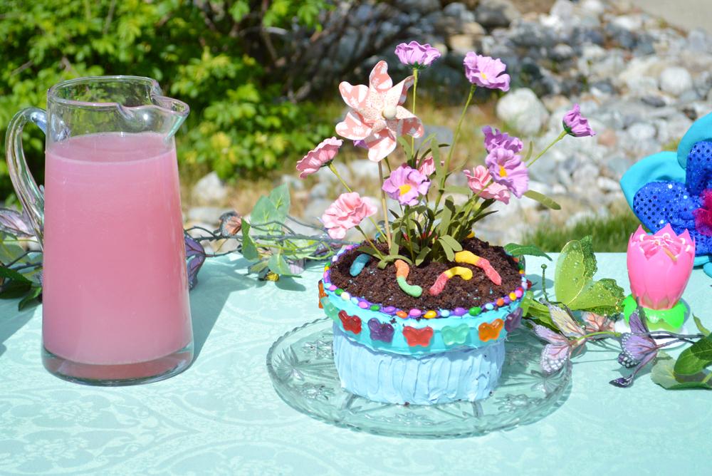 Kids gardening party and potted flower birthday cake