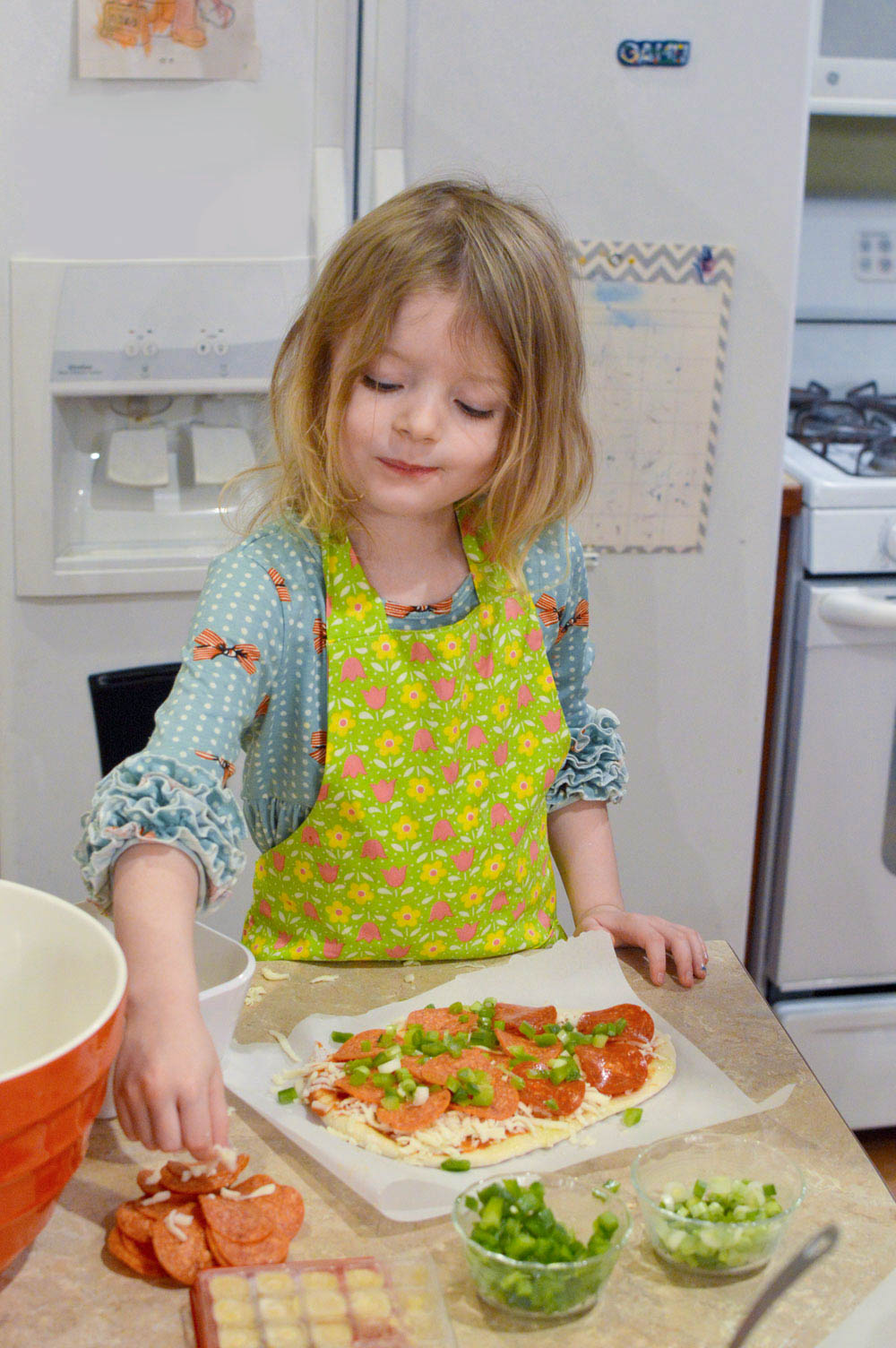 Make homemade pizza with your kids