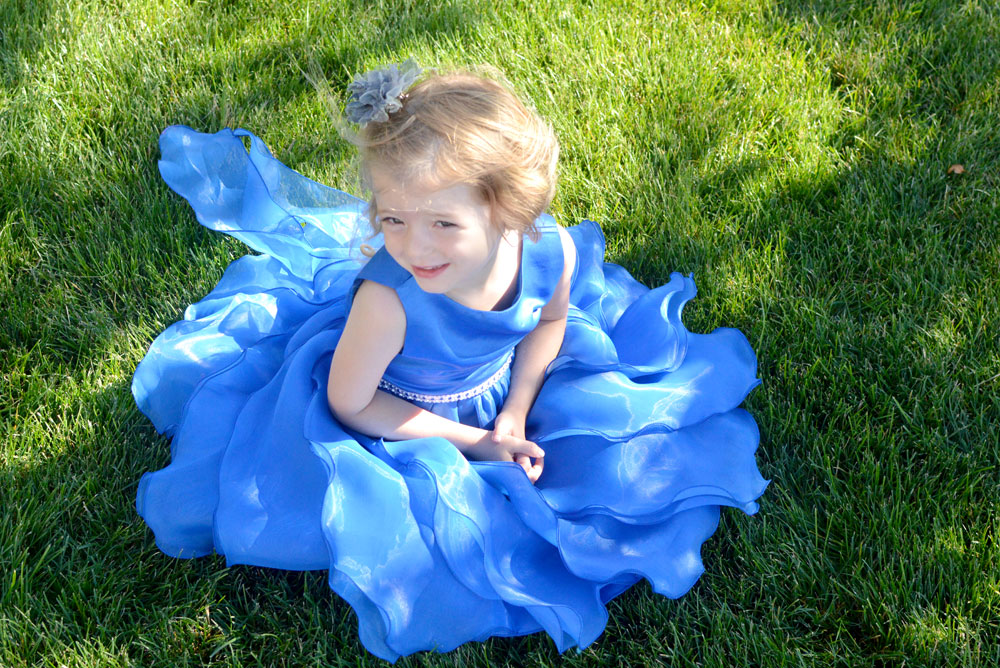 Just Unique Boutique girls' blue dress with ruffles and satin bodice