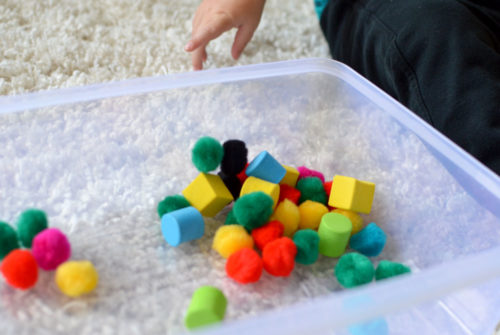 Playing with Pom Poms toddler activity - Mommy Scene