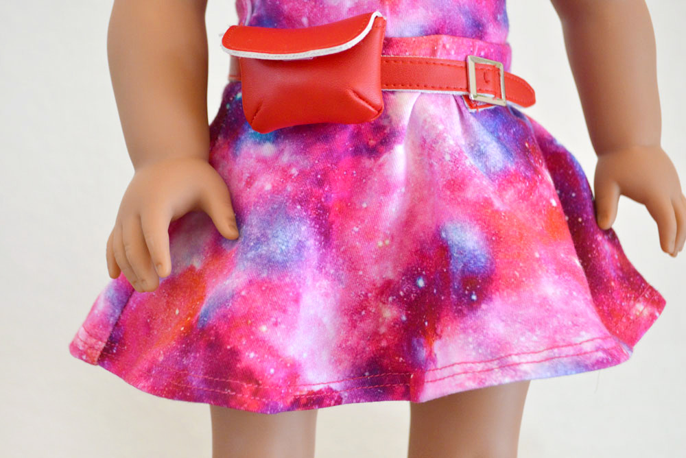 Luciana is ready for space camp dressed in her cosmic print dress