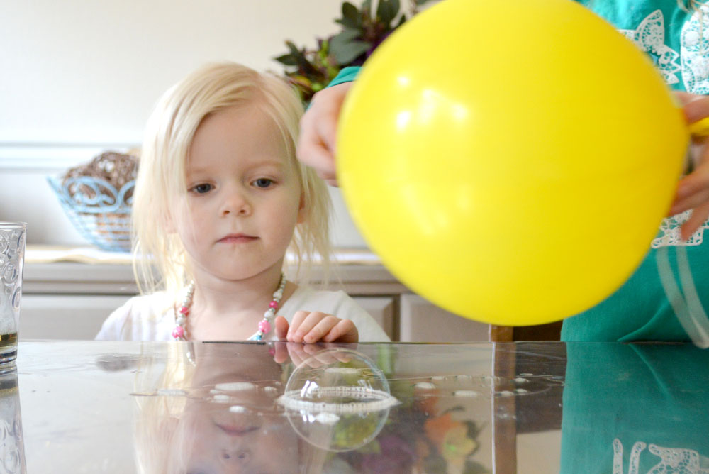 Static electricity kids activity with soap bubbles