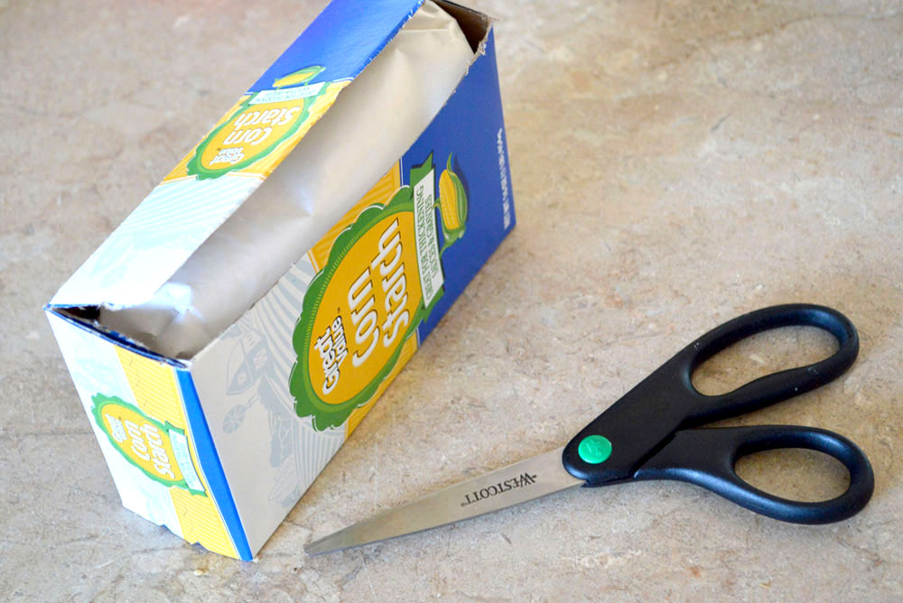Re-purposed cornstarch box coupon organizing idea