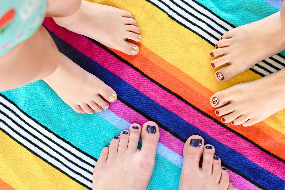 Painting toe nails is a fun summer kids activity