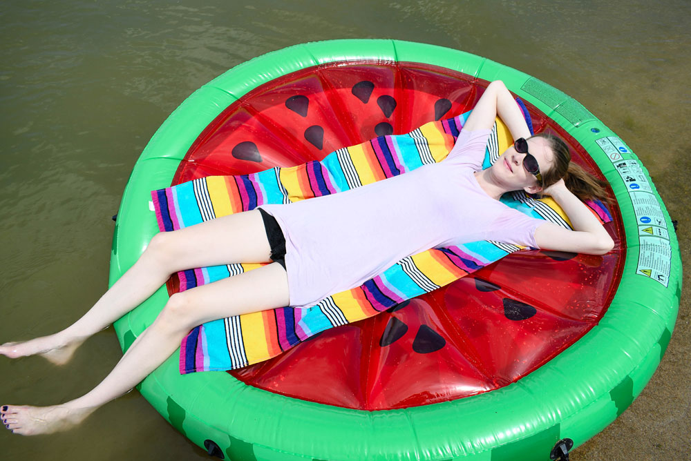 Inflatable watermelon pool toy at the lake - Summer family fun