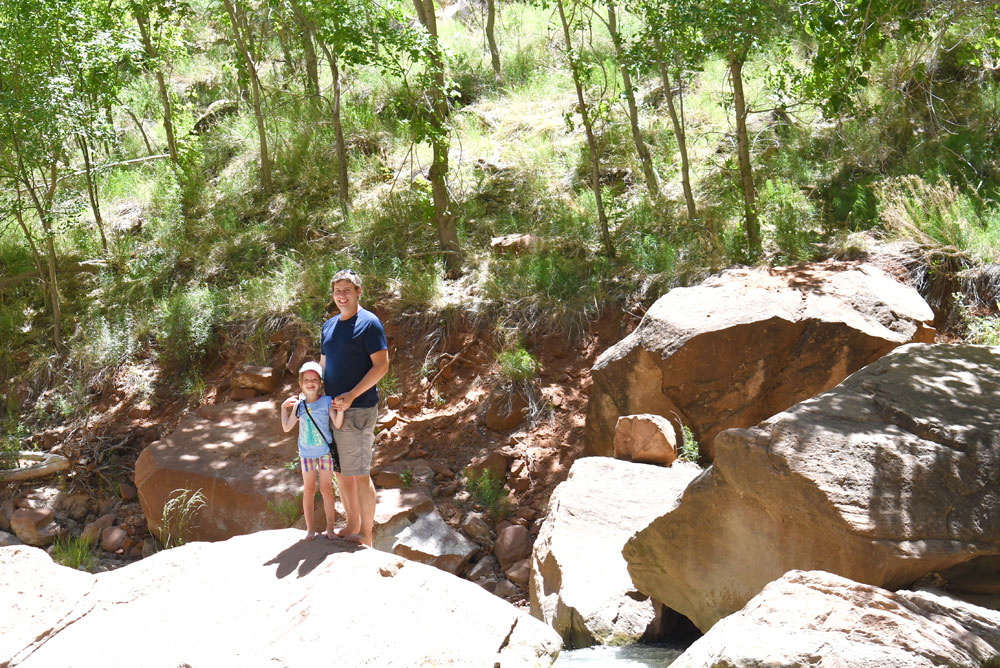 Scrambling over rocks and playing in the river at Zion Canyon