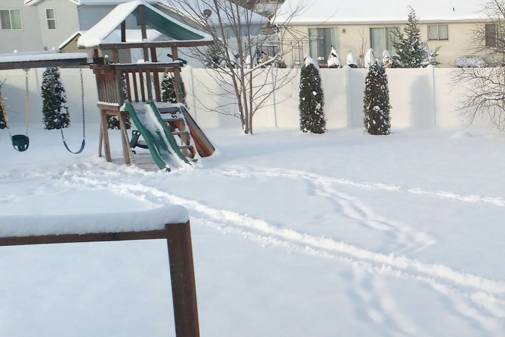 Kids tracks in the snow to the playground