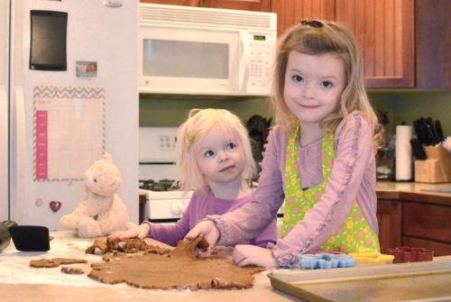 Sisters baking gingerbread cookies