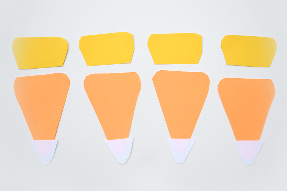 You can easily make your own candy corn pennant banner in a few simple steps