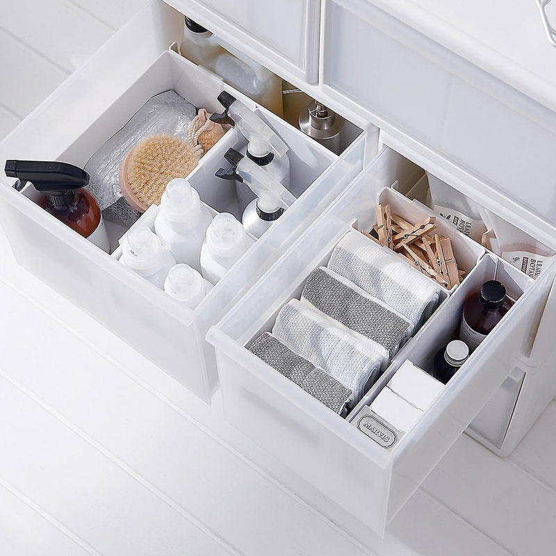 Organize bathroom drawers with dividers and bins