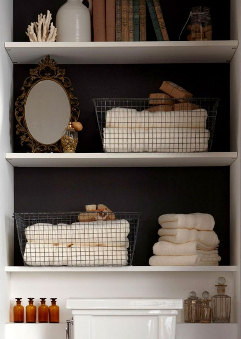 Declutter your bathroom space by adding wire baskets and bins to organize your shelves and drawers.