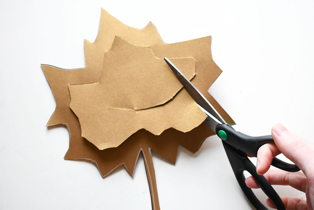 Cut out leaves to make creative tissue paper leaf sun catchers