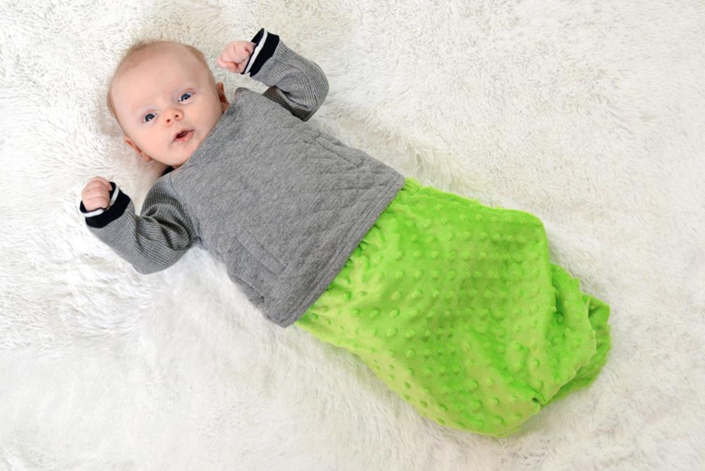 Revelae Kids Cozy Blanket Pouch securely fits around baby's waist