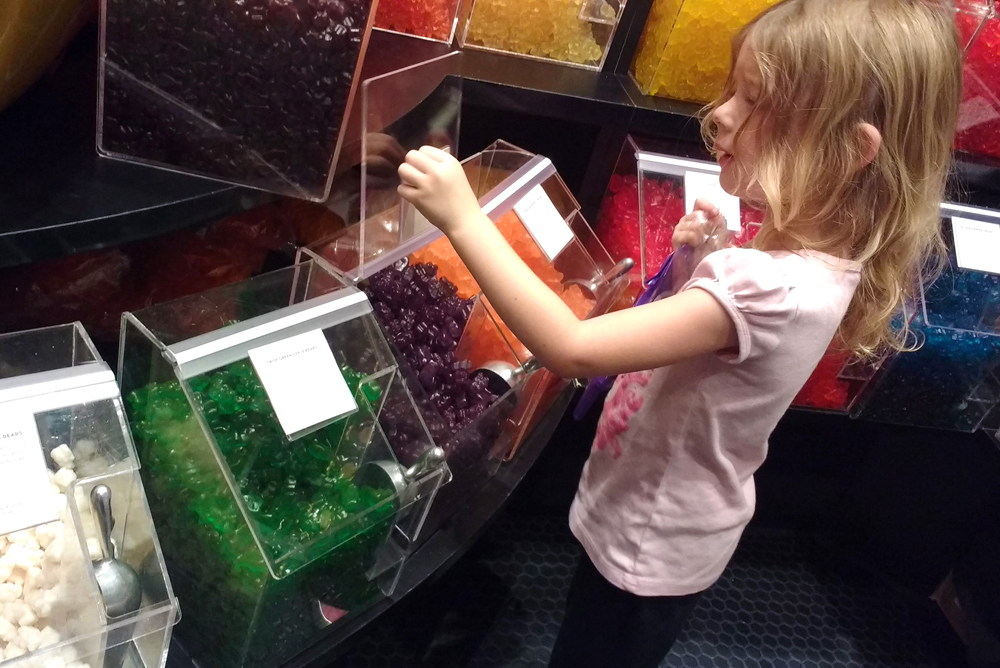 Choosing candy at Lolli and Pops candy store Alderwood Mall in Seattle