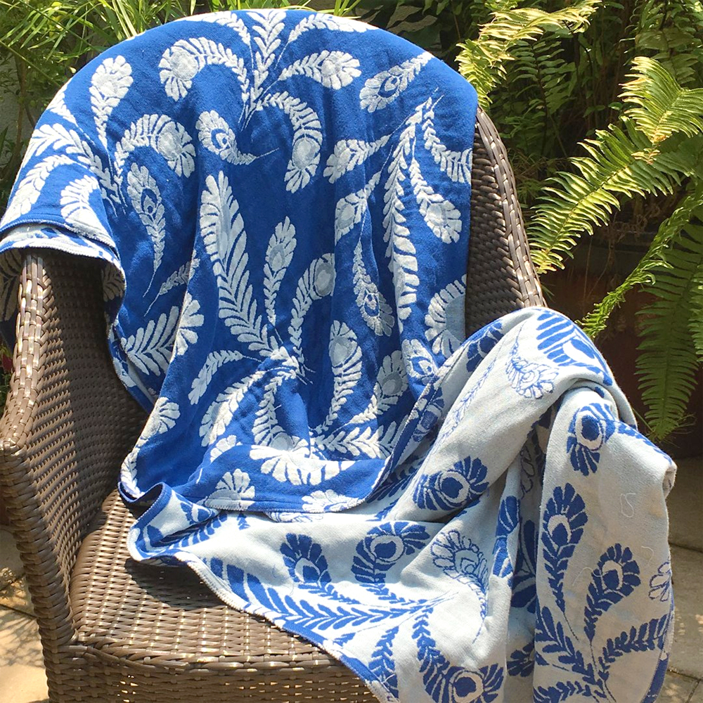 Breganwood Organic cotton throw peacock design