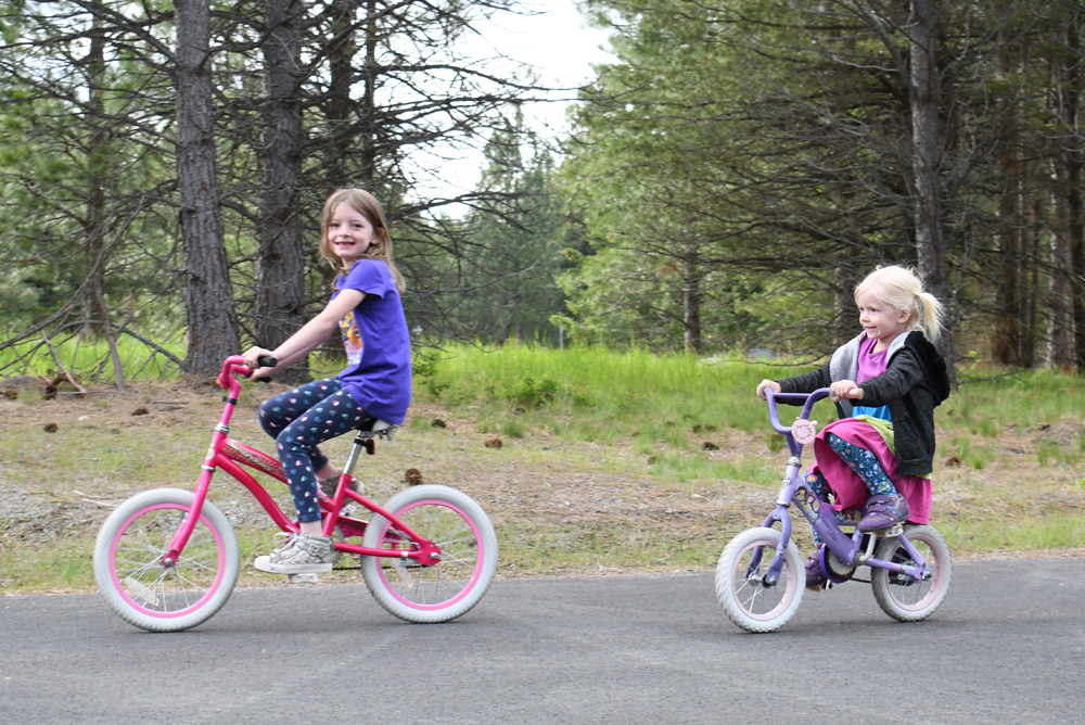 Riding bikes things to do with kids at Farragut State Park near Coeur d'Alene Idaho